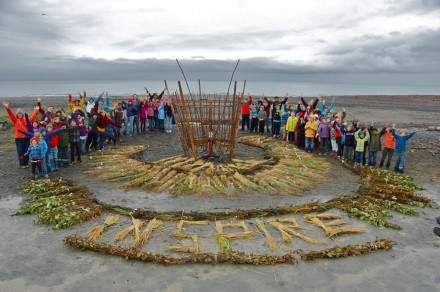 Fireweed elementary students visit the Homer burning basket each year to join in creating organic art. This ground design was created with the bundles of grass, alder, nettles that will be woven into the walls of the big basket. Photo by Mavis Muller.