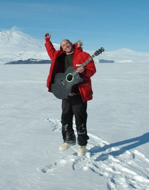 Henry Kaiser above ice in Antarctica.